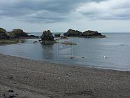 beach and sea at dunure in scotland